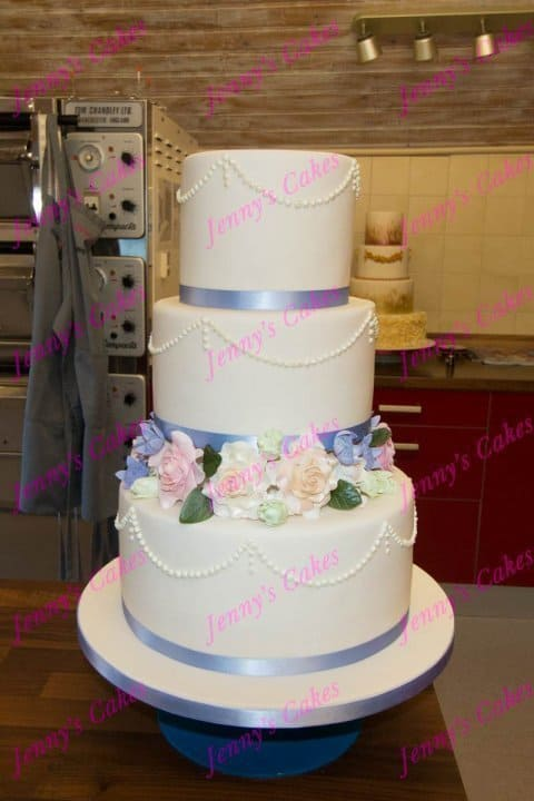 Floral Wedding Cake with Sugar-Crafted Rose border and Piped Pearls