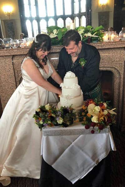 Julie and Rodger with their wedding cake at Mar Hall