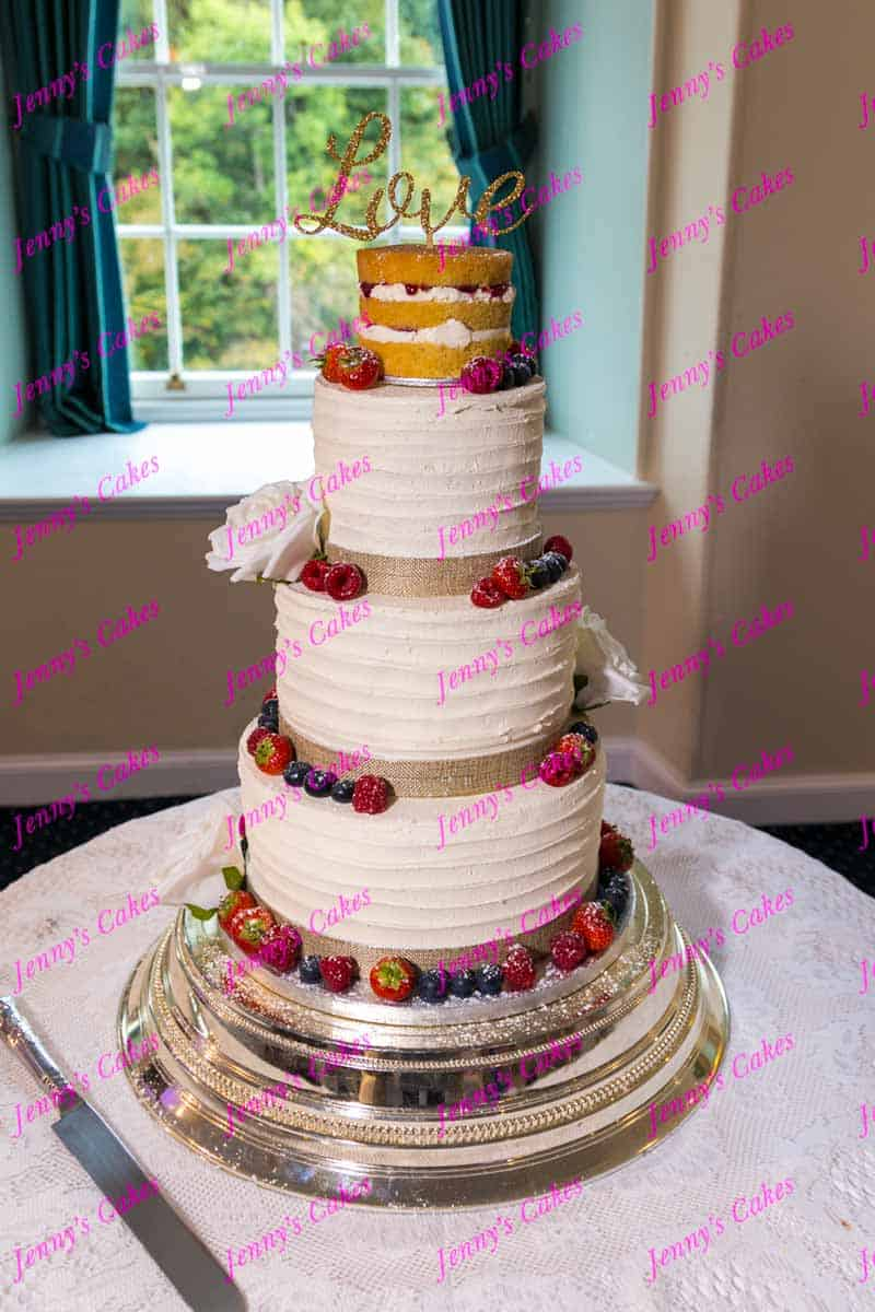 naked wedding cake top tier with buttercream finish