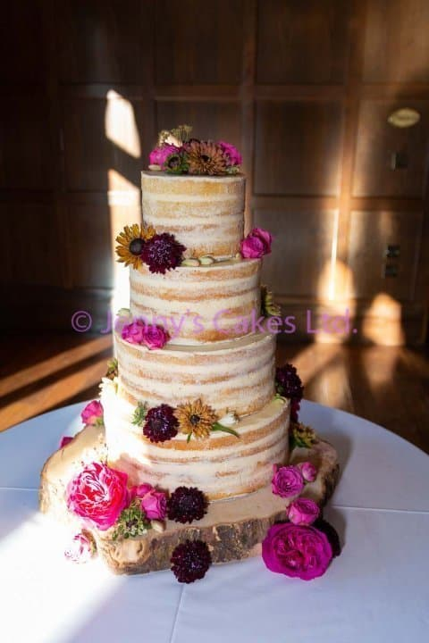 Four tier Semi Naked Wedding Cake with fresh flowers